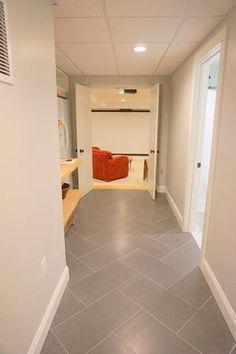 Beton Concrete tiles in herringbone pattern