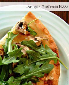 Arugula Mushroom Pizza. possibly add some vegan cheese...