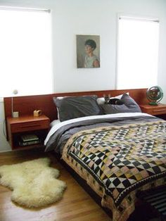 My mom used to have this bed. She also used to have an Arco lamp, a Lane cubist mid-century bedroom set, and fabulous chrome etageres. She sold them/gave them all away while I was at college... #KillMeNow