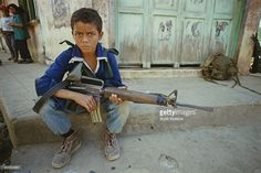 A guerrilla of the FMLN with an rifle in San Francisco Javier, El Salvador, during the Salvadoran Civil War, Get premium, high resolution news photos at Getty Images Salvadoran Civil War, San Francisco Javier, M16 Rifle, African Dance, Santa Ana, Les Religions, War Photography, American War, 12 Year Old