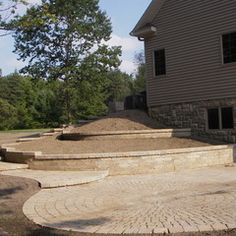 Beautiful paver walkway, stairs, retaining walls and patio by Landscape Creations Nursery, Chesterland, OH
