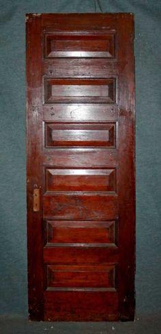 Six panel door has the original antique finish