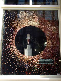 Maybe metallic or foil stickers on clear wrap? Beautiful Window Displays!: anthropologie