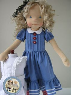Alice in Wonderland doll wearing this beautiful blue dress with pintucks on the bodice, peter pan collar and ruffled hem. by Lalinda.pl