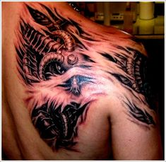 Cool Bio-mechanical Tattoo designs : Biomechanical Tattoo Design For Men On Upper Back