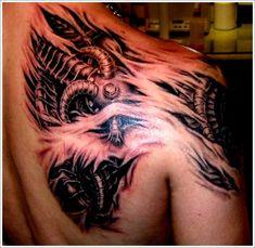 Cool Bio-mechanical Tattoo designs: Biomechanical Tattoo Design For Men On Upper Back ~ Tattoo Design Inspiration