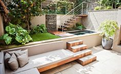 garden design, Wooden Bench With Cushions And Stairs Also Beautiful Water Feature And Green Grass For Small House Garden Design: Beautiful Gardens in small housesBeautiful Gardens in small houses Small House Garden, Small Garden Design, Patio Design, Home And Garden, Diy Garden, Exterior Design, Outdoor Spaces, Outdoor Living, Outdoor Decor