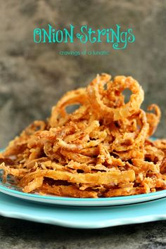 Onion Strings from cravingsofalunati. Seriously sinful and totally worth indulging in! These onion strings are perfect as a side dish or as an appetizer. They are also perfect piled on top of burgers. Finger Food Appetizers, Appetizer Recipes, Snack Recipes, Cooking Recipes, Snacks, Onion Strings, Side Dish Recipes, Vegetable Recipes, Food Dishes