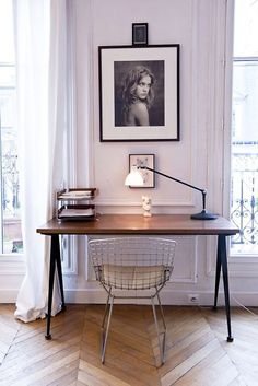 A simple and clutter-free work station with a Bertoia Side Chair.   http://www.bijdendom.nl