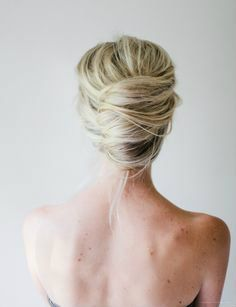 Elegantly simple wedding hair for a breathtaking but busy dress