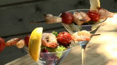 Who says an appetizer has to be served on a plate? Grilled shrimp are served in a martini glass with baby greens to make a shrimptini.