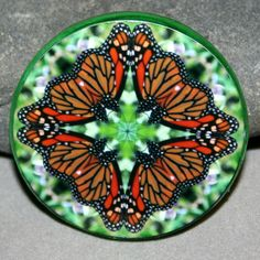 Monarch Butterfly Sacred Geometry Mandala Kaleidoscope glass bead magnet titled Jeweled Jubilee   Butterfly geometric mandala kaleidoscope glass magnet. Magnet is 50mm (just under 2 inches) and has a powerful magnet for secure placement on your fridge or magnetic surface. I have attached my kaleidoscope photo and applied a protective acrylic finish.