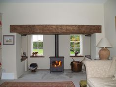 Renovated inglenook fireplace with sandstone hearth, reclaimed clad oak beam and Clearview Vision 500 multi fuel stove fitted in Great Dunmow Essex 2009