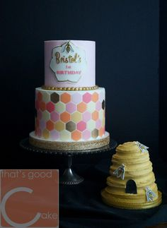 Honey Bee Birthday Cake!  5/7 inch torted and buttercream iced cakes with cut fondant tiles. Edible gold paint. Hand painted details. Smash Cake is buttercream iced and airbrushed with gold luster. Hand painted bees.