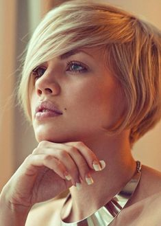 Asymmetrical bob @Jennifer Ellise ;-) I know you won't do it, but this would be so cute!