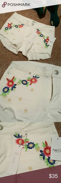 Cute white shorts with floral design White shorts with cute floral design. They are a lil stretchy. Rue21 Shorts Jean Shorts