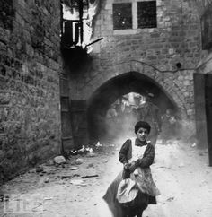 Rachel Levy  Terrified young Jewish girl, Rachel Levy, 7, fleeing from street w. burning bldgs. as the Arabs sack the Holy City after its surrender during Palestinian Civil War. (Photo by John Phillips//Time Life Pictures/Getty Images)