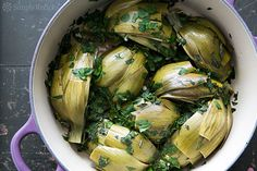 looks like an interesting summer shabbat idea.  Roman-Style Braised Artichokes on Simply Recipes