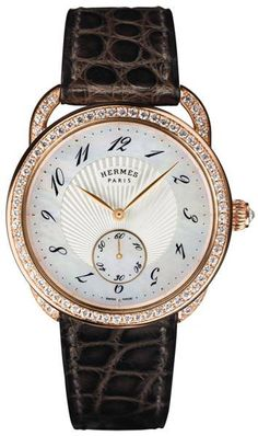 Hermès Arceau ladies' automatic gold and diamond watch. | The Jewellery Editor