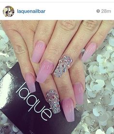 Pink Acrylic nails with rhinestone accent nail.