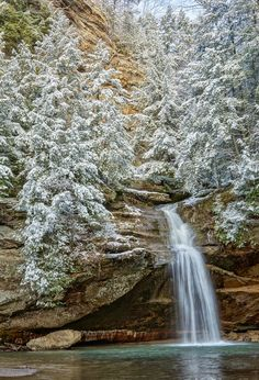 Old Man Winter Falls is a photograph by Jon Reynolds. A snowy scene at the Lower Falls at Old Man's Cave in Hocking Hills State Park in Logan, Ohio. Source fineartamerica.com