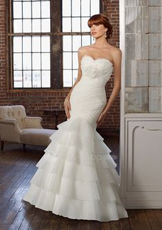 This new 2011 wedding dress features its organza strapless sweetheart neckline with ruched bodice and ruffles layers trumpet skirt sexy mermaid zipper plus buttons back designs.  1. Material: Organza  2. Length: Sweep  3. Neckline: Sweetheart/Strapless   2013 wedding dresses
