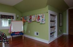Organize kids art work with an IKEA curtain wire