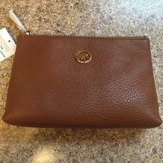 Michael Kors Fulton Leather Travel Case Michael Kors Fulton Leather Travel Case. Color Luggage. New. From website: It makes a perfect travel pouch or cosmetic case, measuring 8 inches (L) x 4 inches (H) x 2.5 inches (W). MICHAEL Michael Kors Bags Travel Bags