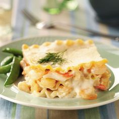 """Seafood Lasagna Recipe -This rich satisfying dish, adapted from a recipe given to me by a friend, is my husband's favorite. I usually serve it on his birthday. It's loaded with scallops, shrimp and crab in a creamy sauce. I consider this the """"crown jewel"""" in my repertoire of recipes. —Elena Hansen, Ruidoso, New Mexico"""