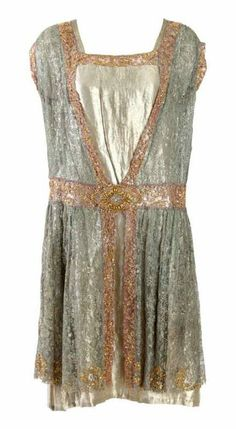 Vintage gold lamé flapper dress with attached lace panel from the roaring 20s.
