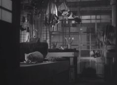 A white cat with a little bib is seen eating on a table in the Japanese film Nagaya shinshiroku (Record of a Tenement Gentleman) (1947).