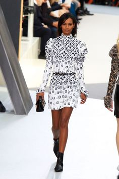 Ghesquiere's Fall 2015 collection for Louis Vuitton takes optic black and white to a new level. The graphic print on this minidress is out of control.
