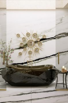 The Diamond Bathtub turns heads wherever it stands. It features a wooden structure finished in a high gloss black varnish, a colour that contrasts perfectly with the gold-painted rim, covered in high gloss varnish. Besides its irregular shape inspired on its jewel's name, it has a built-in oval tub that will provide you with the most comfortable soak.