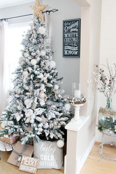 Farmhouse style Christmas dining room.  Beautiful flocked Christmas tree!