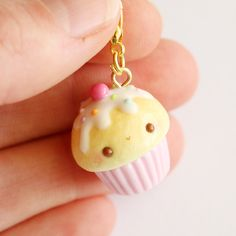 """This+kawaii+""""classic""""+cupcake+charm+is+the+perfect+accessory+to+add+a+touch+of+cuteness+to+your+life!+ It+is+made+out+of+strong+oven+bake+polymer+clay.+The+eyepin+(finding)+is+secured+with+super+glue+to+ensure+durability. It+was+glazed+with+a+high+quality+gloss+varnish+for+protection+and+ex..."""