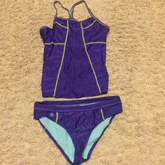 Athleta bathing suit 2 piece Purple with yellow stitching 2 piece bathing suit from Athleta. Gently used but in great condition. Athleta Swim Bikinis