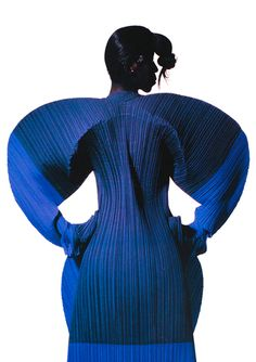 Issey Miyake by Irving Penn 1991. The colour in this photograph give the form and shape an extra depth. The simple use of two different blues emphasises the form ever so slightly. Only noticing if look at the dress close up. Photography and the body really bring to life Miyake's designs.
