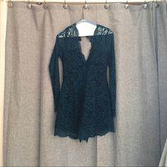 Lovers + Friends Lace Romper Lace Romper with back cut out. So perfect for that special occasion or a night out on the town. Size small. Worn once for a wedding. Lovers + Friends Dresses
