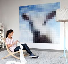 ixxi is a modular hanging system that joins cards together in a pattern to create wall art. The Dutch company lets you enlarge a single image, create a collage, or create an abstract pixelated piece of your choice. You can upload your own image or choose from their catalog of images. The image is then enlarged and divided onto the high quality matte ixxi paper.