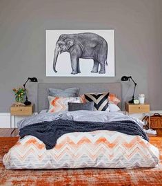 Love this room. Low bed. Grey + color. Black lamps. Fun art.
