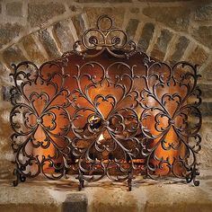 FRONTGATE $1,099 Cast-iron Scrollwork Fireplace Screen with Arch