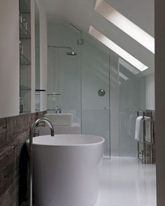 Shower Sloped Ceiling Skylight - Design photos, ideas and inspiration. Amazing gallery of interior design and decorating ideas of Shower Sloped Ceiling Skylight in bathrooms by elite interior designers. Sloped Ceiling Bathroom, Skylight Bathroom, Small Attic Bathroom, Loft Bathroom, Modern Bathroom, Bathroom Storage, Minimalist Bathroom, White Bathroom, Attic Shower