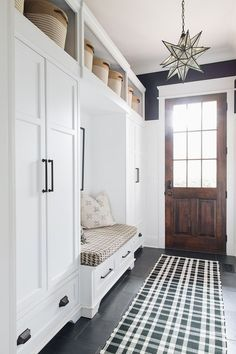 Mudroom Built-ins hides all the kids every day things while a huge walk in closet off that same area hides everything else. I don't think anyone could have too big of a closet in their mudroom #mudroom #builtins #mudroombuiltin