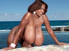 Miosotis Claribel shows off her giant 36KKK breasts on the beach