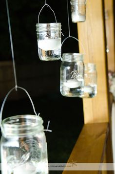 Hanging mason jars with candles paint glitter at the botton!!!!