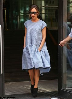 She wore a blue quilted dress, sunglasses and ankle boots.
