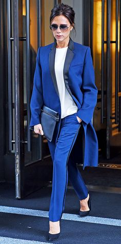 Newly appointed UN Goodwill Ambassador Victoria Beckham spoke at the United Nations press conference in a cool blue tux with contrasting black lapels and a blazer lengthened to hit the knee. She paired her suit separates with a white top, a navy clutch, and classic black pumps.