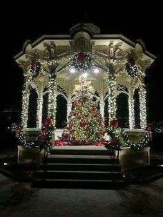 Beautiful Christmas tree and lights decorated outdoors in the gazebo.
