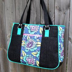 NOTE: YOU ARE PURCHASING A PDF SEWING PATTERN ONLY, NOT THE FINISHED PRODUCT. I AM UNABLE TO ISSUE A REFUND ONCE YOU HAVE PAID FOR YOUR PURCHASE. Introducing the Goin Uptown Tote by Andrie Designs (formerly two pretty poppets)! This darling large tote bag pattern is exactly what you