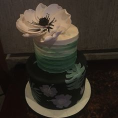 Floral themed wedding cake with handpainted bottom tier, buttercream second tier, topped with a hand made sugar flower. #peridotsweets